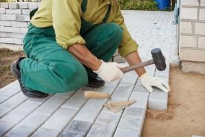 Mason making sidewalk